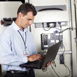 industrial programmer checking computerized machine status
