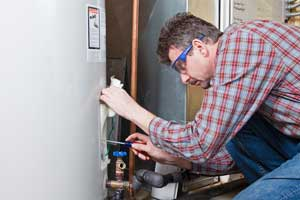 technician-fixing-water-heater